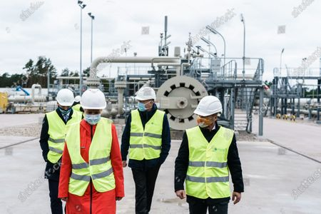 Mecklenburg-Western Pomerania State Premier Manuela Schwesig (2-L) talks with representatives of the Nord Stream 2 pipeline during a visit to the industrial port and the landfall facility of the joint German-Russian pipeline project Nord Stream 2, in Lubmin, Germany, 15 October 2020. The politically controversial pipeline project was put into question in response to the alleged poisoning of Kreml critic Alexei Navalny. Schwesig wants to save the gas pipeline that she regards an important infrastructure project.