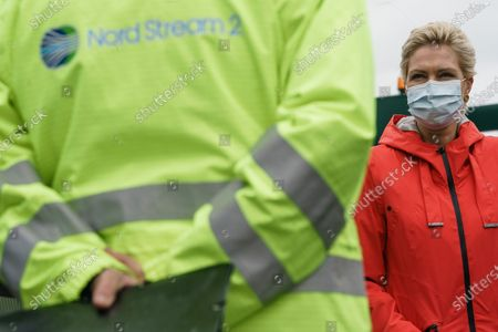 Mecklenburg-Western Pomerania State Premier Manuela Schwesig wears a face mask as she talks to a Nord Stream 2 representative during a visit to the industrial port and the landfall facility of the joint German-Russian pipeline project Nord Stream 2, in Lubmin, Germany, 15 October 2020. The politically controversial pipeline project was put into question in response to the alleged poisoning of Kreml critic Alexei Navalny. Schwesig wants to save the gas pipeline that she regards an important infrastructure project.