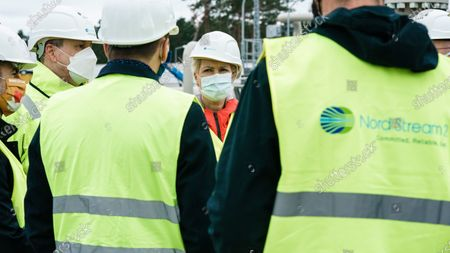 Mecklenburg-Western Pomerania State Premier Manuela Schwesig (C) talks with representatives of the Nord Stream 2 pipeline during a visit to the industrial port and the landfall facility of the joint German-Russian pipeline project Nord Stream 2, in Lubmin, Germany, 15 October 2020. The politically controversial pipeline project was put into question in response to the alleged poisoning of Kreml critic Alexei Navalny. Schwesig wants to save the gas pipeline that she regards an important infrastructure project.