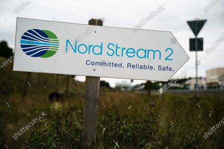 A sign reading 'Nord Stream 2 - Committed. Reliable. Safe.' picutured near the pipeline landfall facility after a visit of Mecklenburg-Western Pomerania State Premier Manuela Schwesig (not in the picture) to the industrial port and the landfall facility of the joint German-Russian pipeline project Nord Stream 2, in Lubmin, Germany, 15 October 2020. The politically controversial pipeline project was put into question in response to the alleged poisoning of Kreml critic Alexei Navalny. Schwesig wants to save the gas pipeline that she regards an important infrastructure project.