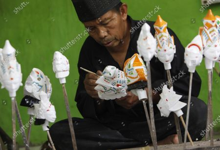 A craftsman Entang Sutisna (73) works on making 'wayang golek' or golek puppet from lame wood (Alstonia scholaris) at the Media Art and Handicraft workshop, in Loji Village, Bogor City, West Java. The traditional West Javanese 'Wayang Golek' puppet for sold to several countries such as the Netherlands, Japan, Korea, Switzerland, Germany and the United States. Production of wayang golek continues even though sales have decreased by 95 percent due to the Covid-19 pandemic.