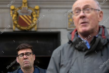 Manchester Metro Mayor Andy Burnham and Sir Richard Leese at a press conference in front of Manchester Central Library in St Peter's Square , central Manchester , as negotiations continue regarding placing the city on a Tier 3 lockdown, closing pubs and limiting the ways in which households can mix, in order to reduce the spread of Coronavirus .