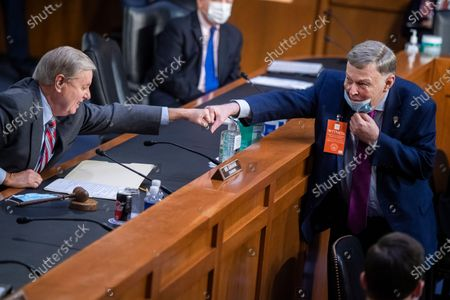 United States Senator Lindsey Graham (Republican of South Carolina), Chairman, US Senate Judiciary Committee, left, greets David L. Brown, vice chair of the Standing Committee on the Federal Judiciary, American Bar Association, during the Senate Judiciary Committee executive business meeting on Supreme Court justice nominee Amy Coney Barrett in Hart Senate Office Building.