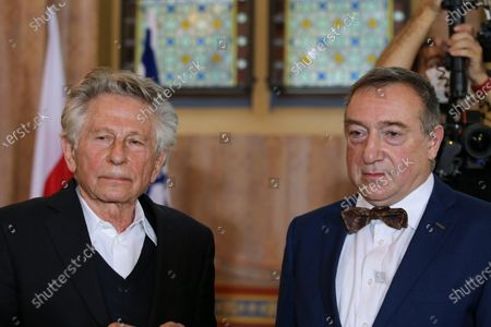 Oscar-winning film director Roman Polanski (L) and family representatives Stanislaw Buchala (R) attend the Righteous Among the Nations Awards ceremony at the the Upper Silesian Jews House of Remembrance  in Gliwice, southern Poland, 15 October 2020. Roman Polanski came to Poland for the awarding ceremony of the Righteous Among the Nations award to a descendant of a Polish couple who hid him during the Holocaust. In 2019, the Yad Vashem Holocaust memorial centre in Jerusalem announced the recognition of the Polish couple Jan and Stefania Buchala, rescuers of Oscar-winning director Roman Polanski, as Righteous Among the Nations. The award, given to individuals who selflessly risked their lives to save Jews from the Nazis, presented to the couple's grandson Stanislaw Buchala.