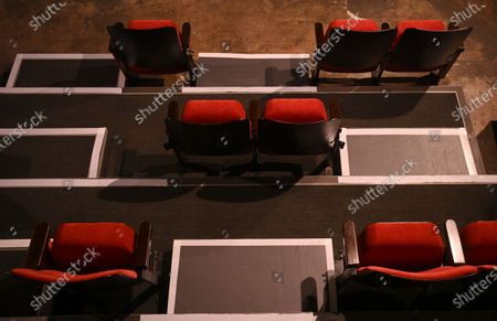 Reduced seating at the independent Arthouse cinema in Crouch End in north London, Britain, 15 October 2020. Due to coronavirus restrictions, the Cineworld and Picturehouse cinema chains have closed indefinitely whilst Vue cinemas have cut back screenings. Major films such as the latest James Bond and Death on the Nile have been rescheduled, and Disney showed its latest release Mulan on its streaming service, which has caused concern for the cinema industry trying to bounce back with Covid-19 restrictions. Roisin McNeill is the manager at the independent Arthouse cinema in Crouch End in north London. She says, 'We have cut down our seating from 80 to 40. We thought that business might be quiet, but actually, on weekends, we are sold out. Customers can find it tricky to follow the face mask rules, but we try to make sure everyone is as safe as possible. Blockbusters such as James Bond being pulled from the release is a real problem for multiplexes and big cinema chains. They rely on these big films for business. As a small independent cinema, we have built a loyal customer following and are able to be successful with independent cinema. Hopefully, this means we can weather the storm although there is always the worry about time if there are no films to show. We have a good relationship with the National Theatre playing performances of plays, which there is a big audience for. With streaming services, there is a view that they are the villain taking content away from cinemas - but we show things that go to Netflix or Amazon after a few weeks, and they are popular. Parasite, the Irishman, and Fleabag all went to streaming services but were good business for the cinema. I don't foresee a time when people don't want to go to the cinema. We get people thinking we won't survive Covid, but we keep positive. There is not much positivity for people, but cinema does the world of good for them. It is great to take people out of the daily life particularly with Covid.