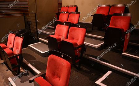 Reduced seating at the independent Arthouse cinema in Crouch End in north London, Britain, 15 October 2020. Due to coronavirus restrictions, the Cineworld and Picturehouse cinema chains have closed indefinitely whilst Vue cinemas have cut back screenings. Major films such as the latest James Bond and Death on the Nile have been rescheduled, and Disney showed its latest release Mulan on its streaming service, which has caused concern for the cinema industry trying to bounce back with Covid-19 restrictions. Roisin McNeill is the manager at the independent Arthouse cinema in Crouch End in north London. She says, 'We have cut down our seating from 80 to 40. We thought that business might be quiet, but actually, on weekends, we are sold out. Customers can find it tricky to follow the face mask rules, but we try to make sure everyone is as safe as possible. Blockbusters such as James Bond being pulled from the release is a real problem for multiplexes and big cinema chains. They rely on these big films for business. As a small independent cinema, we have built a loyal customer following and are able to be successful with independent cinema. Hopefully, this means we can weather the storm although there is always the worry about time if there are no films to show. We have a good relationship with the National Theatre playing performances of plays, which there is a big audience for. With streaming services, there is a view that they are the villain taking content away from cinemas - but we show things that go to Netflix or Amazon after a few weeks, and they are popular. Parasite, the Irishman, and Fleabag all went to streaming services but were good business for the cinema. I don't foresee a time when people don't want to go to the cinema. We get people thinking we won't survive Covid, but we keep positive. There is not much positivity for people, but cinema does the world of good for them. It is great to take people out of the daily life particularly with Covid.'