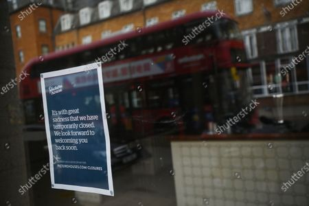 A closed sign is displayed on a Picturehouse cinema in in Crouch End in north London, Britain, 15 October 2020. Due to coronavirus restrictions, the Cineworld and Picturehouse cinema chains have closed indefinitely whilst Vue cinemas have cut back screenings. Major films such as the latest James Bond and Death on the Nile have been rescheduled, and Disney showed its latest release Mulan on its streaming service, which has caused concern for the cinema industry trying to bounce back with Covid-19 restrictions. Roisin McNeill is the manager at the independent Arthouse cinema in Crouch End in north London. She says, 'We have cut down our seating from 80 to 40. We thought that business might be quiet, but actually, on weekends, we are sold out. Customers can find it tricky to follow the face mask rules, but we try to make sure everyone is as safe as possible. Blockbusters such as James Bond being pulled from the release is a real problem for multiplexes and big cinema chains. They rely on these big films for business. As a small independent cinema, we have built a loyal customer following and are able to be successful with independent cinema. Hopefully, this means we can weather the storm although there is always the worry about time if there are no films to show. We have a good relationship with the National Theatre playing performances of plays, which there is a big audience for. With streaming services, there is a view that they are the villain taking content away from cinemas - but we show things that go to Netflix or Amazon after a few weeks, and they are popular. Parasite, the Irishman, and Fleabag all went to streaming services but were good business for the cinema. I don't foresee a time when people don't want to go to the cinema. We get people thinking we won't survive Covid, but we keep positive. There is not much positivity for people, but cinema does the world of good for them. It is great to take people out of the daily life particularly with Covid.'