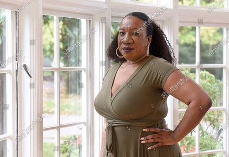 Tarana Burke, founder and leader of the #MeToo movement, stands in her home in Baltimore on . As the #MeToo movement marks the third year since it received global recognition, Burke is working to make sure it remains inclusive and reclaims its original intent: A focus on marginalized voices and experiences