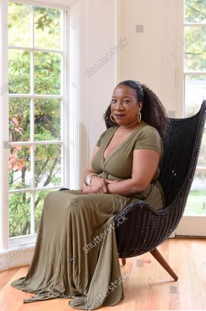 Stock Photo of Tarana Burke, founder and leader of the #MeToo movement, stands in her home in Baltimore on . As the #MeToo movement marks the third year since it received global recognition, Burke is working to make sure it remains inclusive and reclaims its original intent: A focus on marginalized voices and experiences