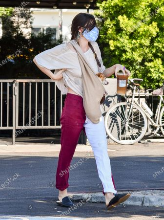 Scout LaRue Willis is seen out grabbing coffee with her dog wrapped tightly in her arms