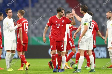 Bayern's Javi Martinez, left, salutes Duren's Mario Weber at the end of the 1st round German Soccer Cup match between FC Bayern Munich and FC Duren, at the Allianz Arena in Munich, Germany