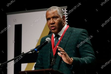 Stock Photo of Billionaire businessman Robert F. Smith speaks after receiving the W.E.B. Dubois Medal for contributions to black history and culture, during ceremonies at Harvard University in Cambridge, Mass. Federal prosecutors have charged Houston billionaire Robert Brockman, not seen, with $2 billion tax fraud in largest such fraud case against an American. Prosecutors also announced, that Robert Smith, founder and chairman of investment firm Vista Equity Partners, will cooperate in the investigation and pay $139 million to settle a tax probe