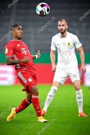 Stock Image of Bayern's Douglas Costa (L) in action during the German DFB Cup first round soccer match between Bayern Muenchen and FC Dueren in Munich, Germany, 15 October 2020.