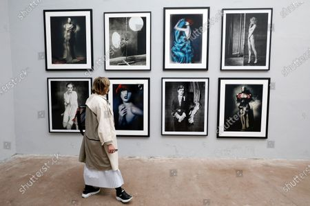 A visitor looks at pictures on display in the exhibition 'Silenzio' by Italian photographer Paolo Roversi during the 35th International Festival of Fashion and Photography in Hyeres, southern France, 15 October 2020. The festival runs from 15 to 18 October 2020.