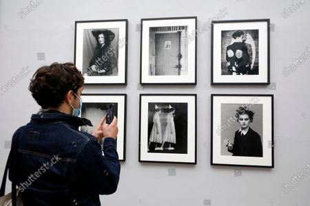 Stock Image of A visitor looks at pictures on display in the exhibition 'Silenzio' by Italian photographer Paolo Roversi during the 35th International Festival of Fashion and Photography in Hyeres, southern France, 15 October 2020. The festival runs from 15 to 18 October 2020.