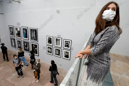Visitors look at pictures on display in the exhibition 'Silenzio' by Italian photographer Paolo Roversi during the 35th International Festival of Fashion and Photography in Hyeres, southern France, 15 October 2020. The festival runs from 15 to 18 October 2020.