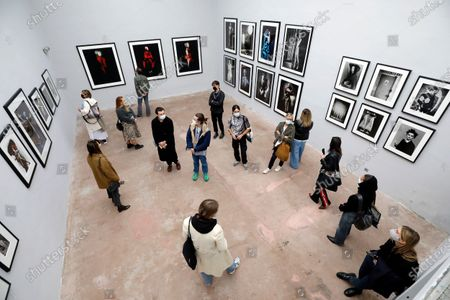 Stock Picture of Visitors look at pictures on display in the exhibition 'Silenzio' by Italian photographer Paolo Roversi during the 35th International Festival of Fashion and Photography in Hyeres, southern France, 15 October 2020. The festival runs from 15 to 18 October 2020.