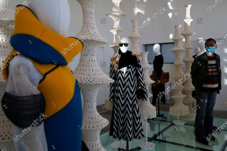 A visitor looks at creations on display in the exhibition 'I Curate' by British fashion stylist Jonathan Anderson during the 35th International Festival of Fashion and Photography in Hyeres, southern France, 15 October 2020. The festival runs from 15 to 18 October 2020.