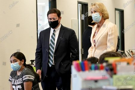 Stock Photo of Arizona Gov. Doug Ducey and U.S. Secretary of Education Betsy DeVos observe a classroom setting, at the Phoenix International Academy in Phoenix