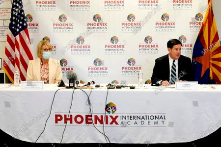 Stock Picture of Arizona Gov. Doug Ducey, right, and U.S. Secretary of Education Betsy DeVos attend a roundtable discussion, at the Phoenix International Academy in Phoenix