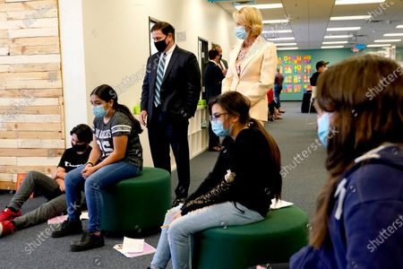 Stock Image of Arizona Gov. Doug Ducey and U.S. Secretary of Education Betsy DeVos observe a classroom setting, at the Phoenix International Academy in Phoenix