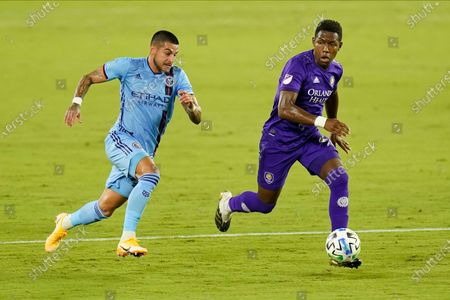Stock Photo of New York City FC defender Ronald Matarrita, left, tries to stop Orlando City midfielder Andres Perea from advancing the ball during the first half of an MLS soccer match, in Orlando, Fla
