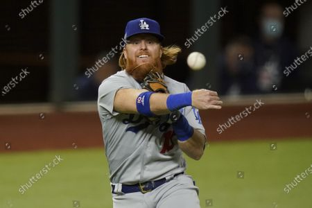 Stock Photo of Los Angeles Dodgers third baseman Justin Turner throws out Atlanta Braves' Travis d'Arnaud out at first during the second inning in Game 4 of a baseball National League Championship Series, in Arlington, Texas