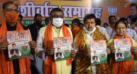 Incumbent MLA and BJP candidate Nitin Naveen (3R) for Bankipur assembly seat releases his report card along with Union minister Ravi Shankar Prasad and others after filing nomination, at Vidyapati Bhawan on October 15, 2020 in Patna, India.