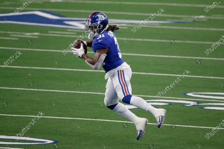 New York Giants running back Devonta Freeman (31) catches a pass against the Dallas Cowboys during the first half of an NFL Football game in Arlington, Texas