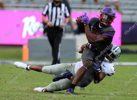 Wide receiver John Stephens Jr. (7) is brought down by Kansas State linebacker Justin Hughes (32) in an NCAA college football game, in Fort Worth, Texas