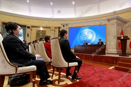President of Kyrgyzstan Sooronbay Jeenbekov (R) attends a parliamentary session at the Ala-Archa residence in Bishkek, Kyrgyzstan, 16 October 2020. Jeenbekov resigned on 15 October amid mounting protests over the result of the elections held on 04 October.