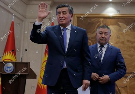 President of Kyrgyzstan Sooronbay Jeenbekov (L) leaves after a parliamentary session at the Ala-Archa residence in Bishkek, Kyrgyzstan, 16 October 2020. Jeenbekov resigned on 15 October amid mounting protests over the result of the elections held on 04 October.