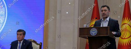Kyrgyz Prime Minister Sadyr Japarov (R) speaks at an extraordinary session of the Jogorku Kenesh for the resignation of President Sooronbay Jeenbekov (L), in Bishkek, Kyrgyzstan, 16 October 2020. Jeenbekov resigned on 15 October amid mounting protests over the result of the elections held on 04 October.
