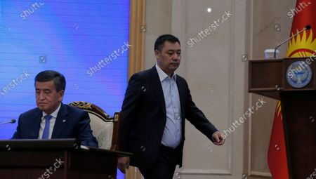 Kyrgyz Prime Minister Sadyr Japarov (R) walks to the stage at an extraordinary session of the Jogorku Kenesh for the resignation of President Sooronbay Jeenbekov (L), in Bishkek, Kyrgyzstan, 16 October 2020. Jeenbekov resigned on 15 October amid mounting protests over the result of the elections held on 04 October.
