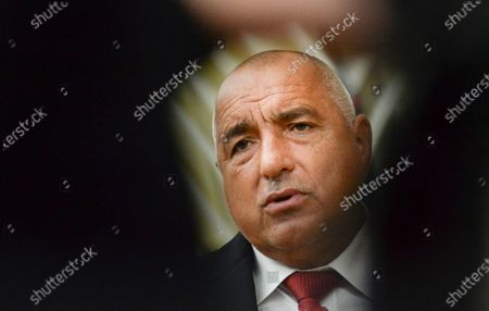Bulgaria's Prime Minister Boyko Borissov speaks with the media as he arrives for an EU summit in Brussels, . European Union leaders meet for the second day of an EU summit, amid the worsening coronavirus pandemic, to discuss topics on foreign policy issues