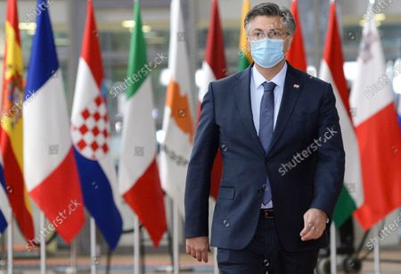 Croatia's Prime Minister Andrej Plenkovic arrives for an EU summit in Brussels, . European Union leaders meet for the second day of an EU summit, amid the worsening coronavirus pandemic, to discuss topics on foreign policy issues
