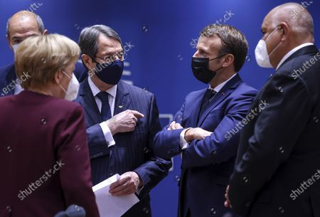 French President Emmanuel Macron, second right, speaks with, from left, Slovenia's Prime Minister Janez Jansa, German Chancellor Angela Merkel, Cypriot President Nicos Anastasiades and Bulgaria's Prime Minister Boyko Borissov during a round table meeting at an EU summit in Brussels, . European Union leaders meet for the second day of an EU summit, amid the worsening coronavirus pandemic, to discuss topics on foreign policy issues