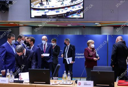 German Chancellor Angela Merkel, second right, speaks with Bulgaria's Prime Minister Boyko Borissov, right, during a round table meeting at an EU summit in Brussels, . European Union leaders meet for the second day of an EU summit, amid the worsening coronavirus pandemic, to discuss topics on foreign policy issues
