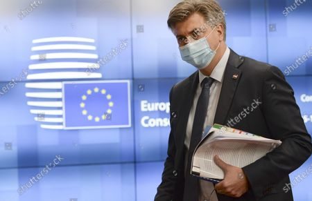 Croatia's Prime Minister Andrej Plenkovic leaves the building during departures at the end of an EU summit in Brussels, . European Union leaders met for the second day of an EU summit, amid the worsening coronavirus pandemic, to discuss topics on foreign policy issues