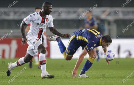 Verona's Andrea Favilli loses his footing in front of Cristian Zapata.