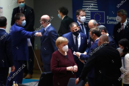 Stock Photo of German Chancellor Angela Merkel (C) speaks with Bulgaria's Prime Minister Boyko Borissov during a round table meeting at an EU summit in Brussels, Belgium, 16 October 2020. European Union leaders meet for the second day of an EU summit, amid the worsening coronavirus pandemic, to discuss topics on foreign policy issues. (AP Photo/Francisco Seco, Pool)