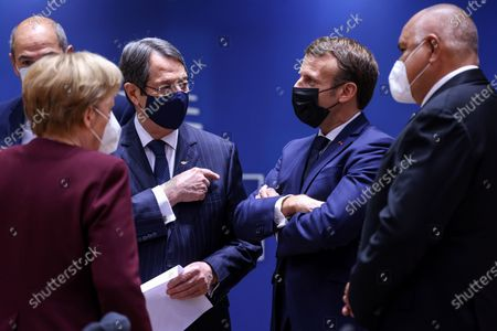 (R-L) Bulgaria's Prime Minister Boyko Borissov, France's President Emmanuel Macron, Cyprus' President Nicos Anastasiades and Germany's Chancellor Angela Merkel, wearing a face mask, speak with each others during a face-to-face meeting on the second day of a two days EU summit, in Brussels, Belgium, 16 October 2020.
