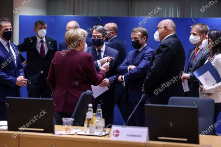Stock Picture of (R-L) Bulgaria's Prime Minister Boyko Borissov, France's President Emmanuel Macron, Cyprus' President Nicos Anastasiades and Germany's Chancellor Angela Merkel, wearing face masks, attend a face-to-face meeting on the second day of a two days EU summit, in Brussels, Belgium, 16 October 2020.