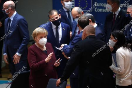 German Chancellor Angela Merkel (2-L) speaks with Bulgaria's Prime Minister Boyko Borissov, (C) during a round table meeting at an EU summit in Brussels, Belgium, 16 October 2020. European Union leaders meet for the second day of an EU summit, amid the worsening coronavirus pandemic, to discuss topics on foreign policy issues.
