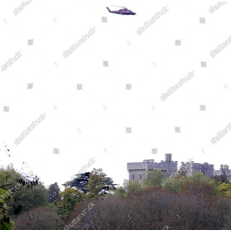 Queen Elizabeth II arrives back at Windsor Castle by helicopter after visiting Porton Down Near Salisbury