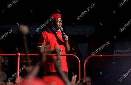 Economic Freedom Fighters leader Julius Malema addresses supporters outside the magistrates court in Senekal, South Africa, where two suspects were to appear on charges of killing a white farmer in the area. A tense standoff between white farmers and Black activists gripped Senekal on Friday. More than 100 police patrolled the area in front of the courthouse in the Free State province and used barbed wire to separate the rival groups