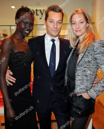 Seb Bishop, his wife Heidi Bishop, and Alek Wek