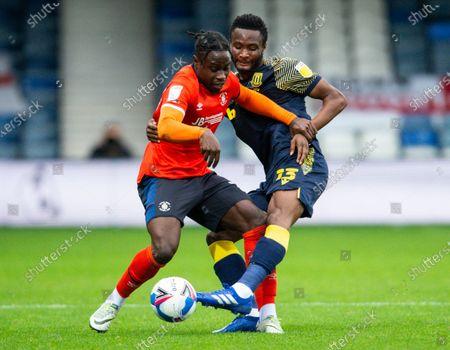 Pelly Ruddock Mpanzu of Luton Town and John Obi Mikel of Stoke City
