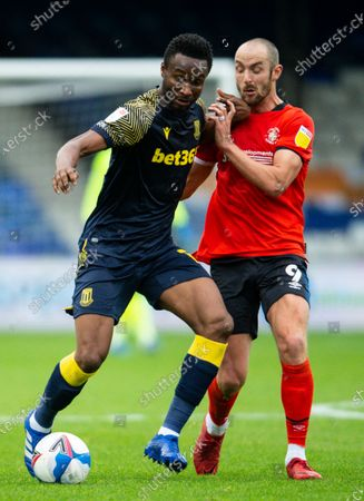 John Obi Mikel of Stoke City and Danny Hylton of Luton Town
