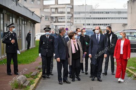 French Prime Minister Jean Castex (3-R) arrives with mayor of Lille Martine Aubry (4-L) at the Centre Hospitalier Universitaire (CHU) hospital during his visit in Lille, France, 16 October 2020.